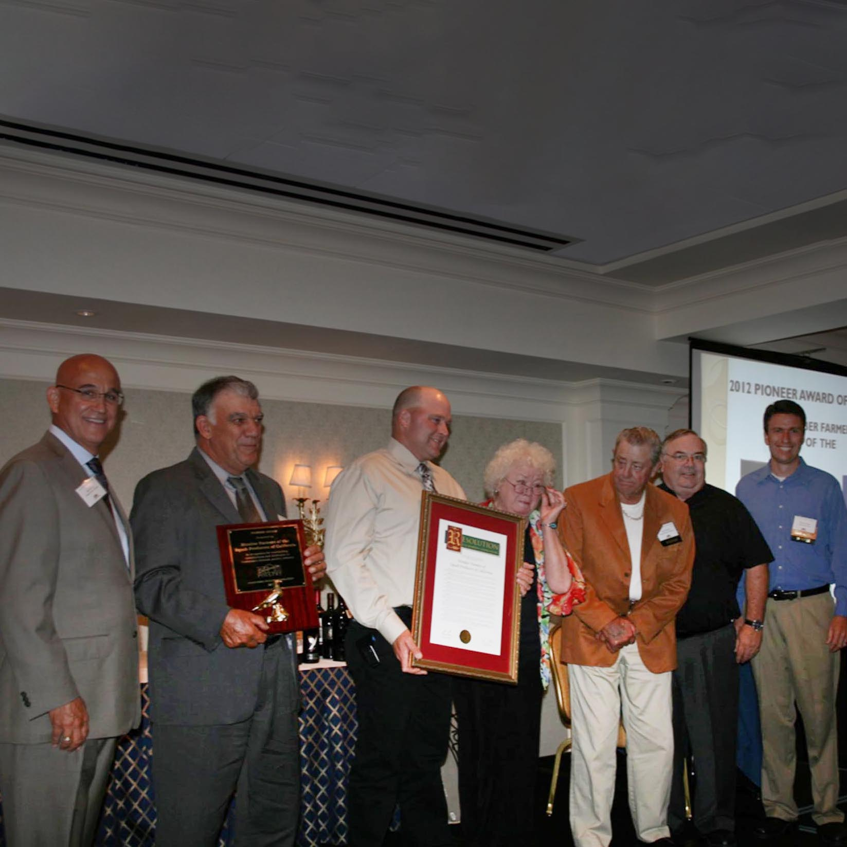 "2012. Farmer members of the SPOC Co-op were presented with the ""Pioneer of the Year"" Award by the California Poultry Association."