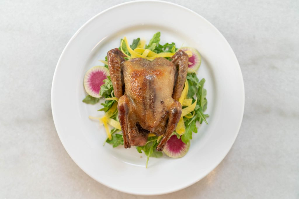 Whole Roasted Squab on Arugula
